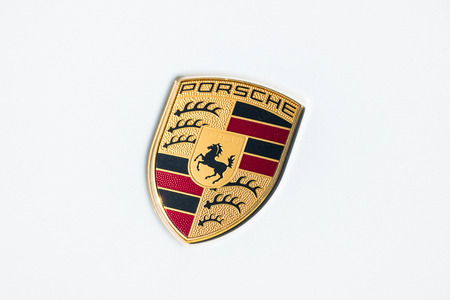 ferdinand: AACHEN, GERMANY MARCH, 2017: Porsche Sign Close Up on a white car. Ferdinand Porsche founded the company in 1931 with main offices in the center of Stuttgart.