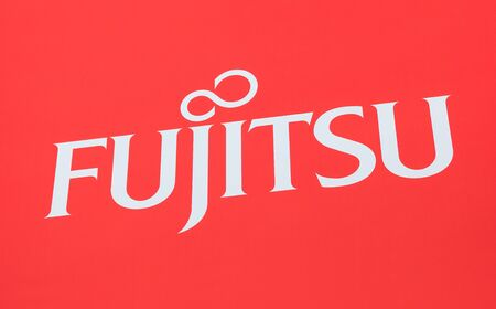 HANNOVER, GERMANY MARCH, 2017: The logo of the brand Fujitsu. Fujitsu is a Japanese multinational information technology equipment and services company headquartered in Tokyo, Japan. Publikacyjne