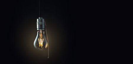 led lighting: Old vintage hanging light bulb over dark background