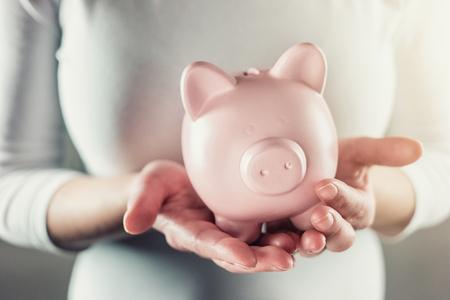 christmas budget: Woman keep a piggy bank carefully