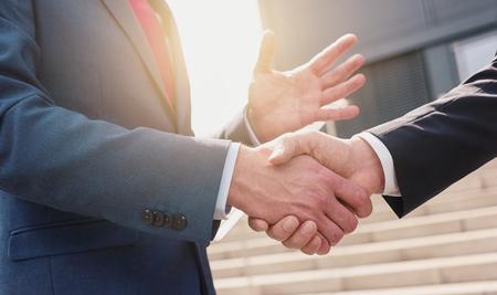 business skeptical: Business people making handshake - business concept image