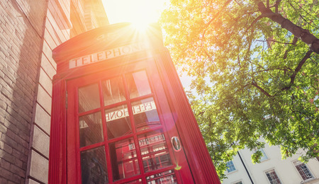 antique booth: Red phone box at summer in London, United Kingdom Stock Photo