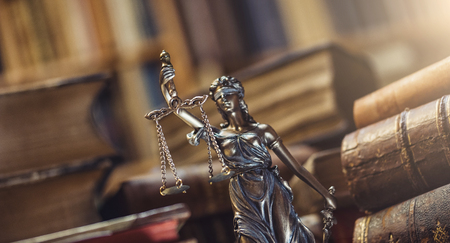 female police: Lady Justice Statue in a courtroom Stock Photo