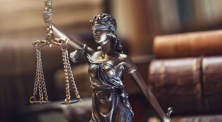 Lady Justice Statue with old books Stock Photo