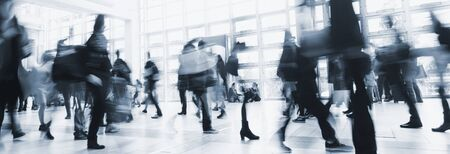 Anonymous crowd of people walking Stock Photo