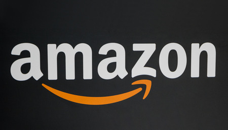 COLOGNE, GERMANY SEPTEMBER, 2017: Amazon logo on black background. Amazon is an American electronic e-commerce company distribution worlwide.
