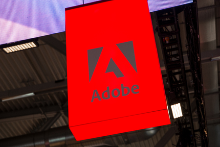 COLOGNE, GERMANY SEPTEMBER, 2017: Adobe Logo. Adobe is a multinational software company that produces and sells multimedia and creativity software.