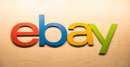COLOGNE, GERMANY SEPTEMBER, 2017: Ebay logo on a wall. Ebay is an American multinational corporation and e-commerce company, providing consumer-to-consumer and business-to-consumer sales services. Editorial