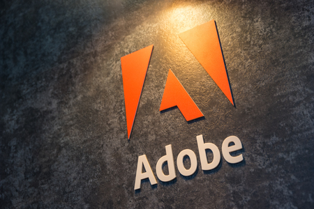 COLOGNE, GERMANY SEPTEMBER, 2017: Adobe Systems Logo. Adobe is a multinational software company that produces and sells multimedia and creativity software.