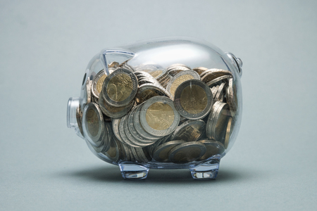 Full piggy bank with euro coins