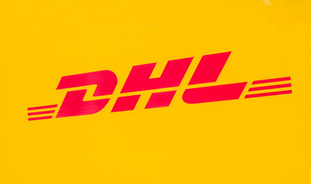 COLOGNE, GERMANY OCTOBER, 2017: Yellow DHL logo on a truck. DHL Express is a division of the German worldwide logistics company.