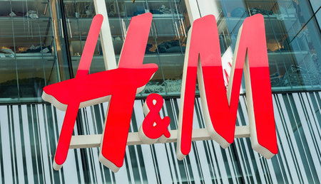 retailer: COLOGNE, GERMANY OCTOBER, 2017: H & M logo on a store. H & M Hennes & Mauritz AB is a Swedish multinational retail-clothing company, known for its fast-fashion clothing. Editorial