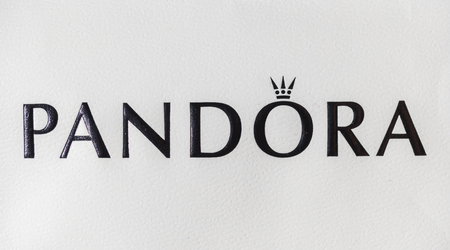AACHEN, GERMANY OCTOBER, 2017: Logo of a Pandora on a bag. Pandora is a company founded in 1982 that designs manufactures and markets jewelry.