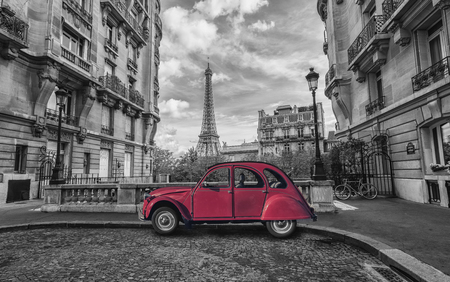 Eiffel tower in Paris and red retro car in black and white color key