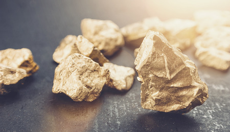 big gold nugget finance concept Stock Photo