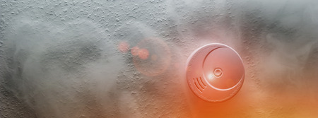 Smoke detector on a roof detects smoke and give alarm