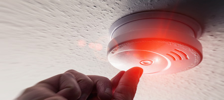 Testing Domestic Home Smoke Alarm detector Banque d'images