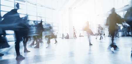 blurred business people walking by Stock Photo