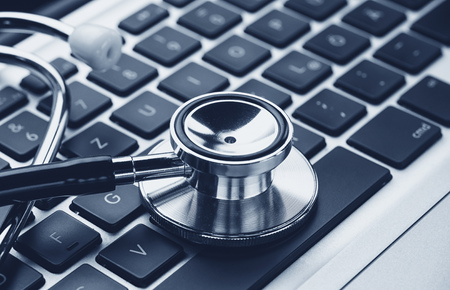 Stethoscope over a laptop keyboard - cybercrime concept image