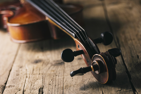 Antique violin on a wooden floor Stock Photo