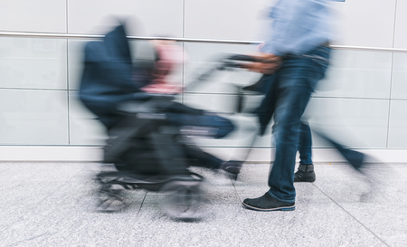 Family with pram rushing in a corridor Stock Photo