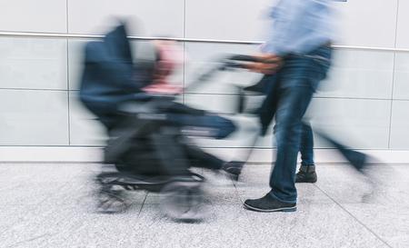 Family with pram rushing in a corridor Stockfoto - 96408311
