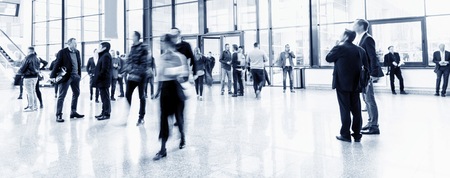 Crowd of blurred business people in a trade fair hall Imagens