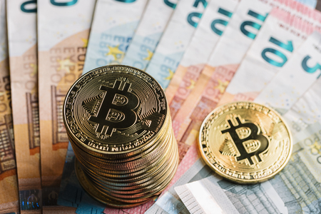 bitcoins stack Cryptocurrency on top of Euro banknotes