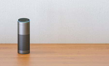 voice controlled smart speaker on a table with copy space for individual text