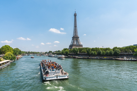 Paris Eiffel Tower and river Seine in Paris, France. Eiffel Tower is one of the most iconic landmarks of Paris.