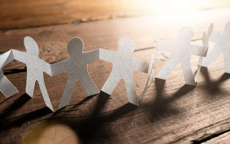 Paper People Teamwork Holding Hands. Business concept image