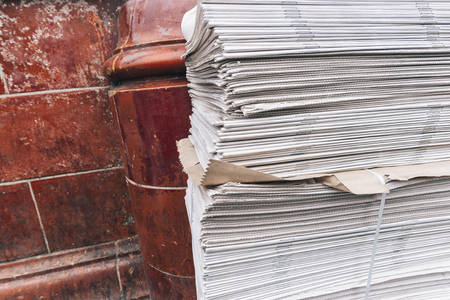 newspaper stack on street