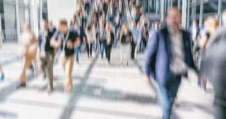 Defocused crowd of people walking street Stock Photo