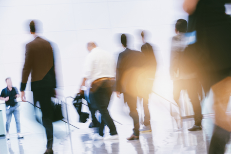 Crowd of anonymous people walking in the airport Stock Photo