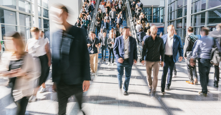 blurred business people crowd at a trade fair Stock Photo