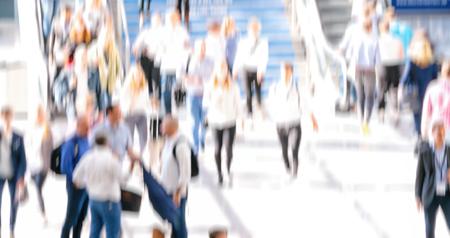 defocused crowd of anonymous people walking