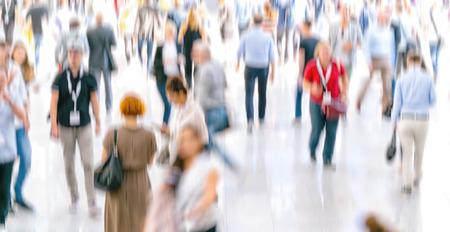 Defocused crowd of people walking at a trade fair Stock Photo