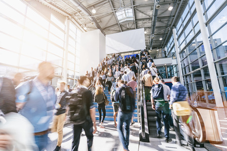 blurred business people at a trade fair with banner for copy space Stock Photo