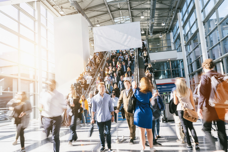 Crowd of people walking with copy space banner