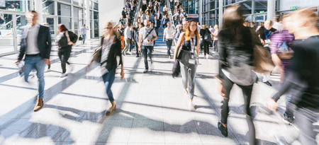 Crowd of people walking at the trade show Stock Photo