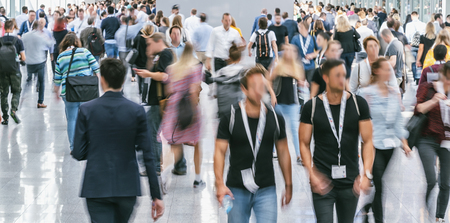 blurred business people at a trade fair Stock Photo