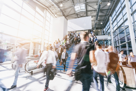 blurred business people at a trade show, with copy space banner Stock Photo