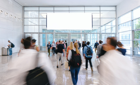blurred business people at a trade fair, including copy space Stock Photo