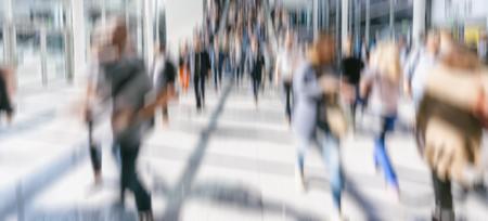 Defocused crowd of people walking street in London Stock Photo