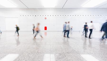fair trade visitors walking in a clean futuristic corridor Stock Photo