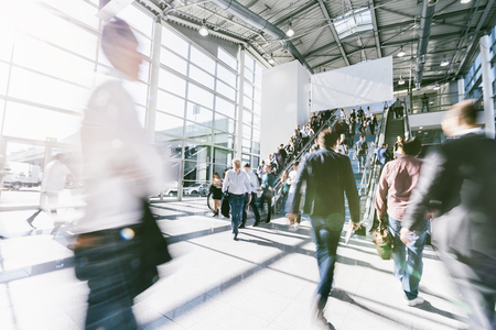 crowd of anonymous blurred business people at a trade fair Stock Photo