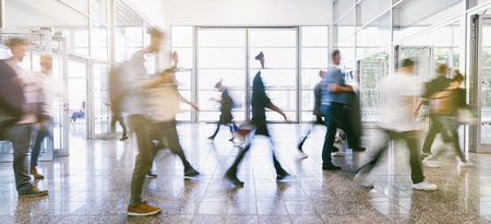 Crowd of blurred business people at a trade fair floor Stock Photo