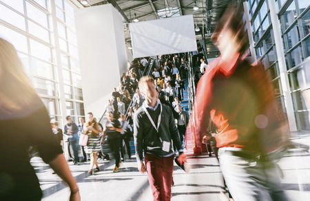 crowd of anonymous blurred business people at a tradeshow Stock Photo