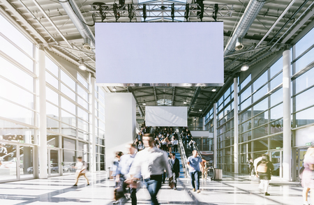 Large crowd of business people walking at a trade fair Stock Photo