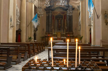 sanctified: Candles inside of Oratorio di San Giovanni church in Montepulciano, Tuscany, Italy. Stock Photo